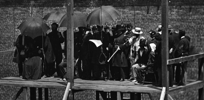 Death warrant for Lincoln assassination conspirators David Herold, Lewis Powell, Mary Surratt, and George Azterodt being read aloud by General John F. Hartranft on the gallows