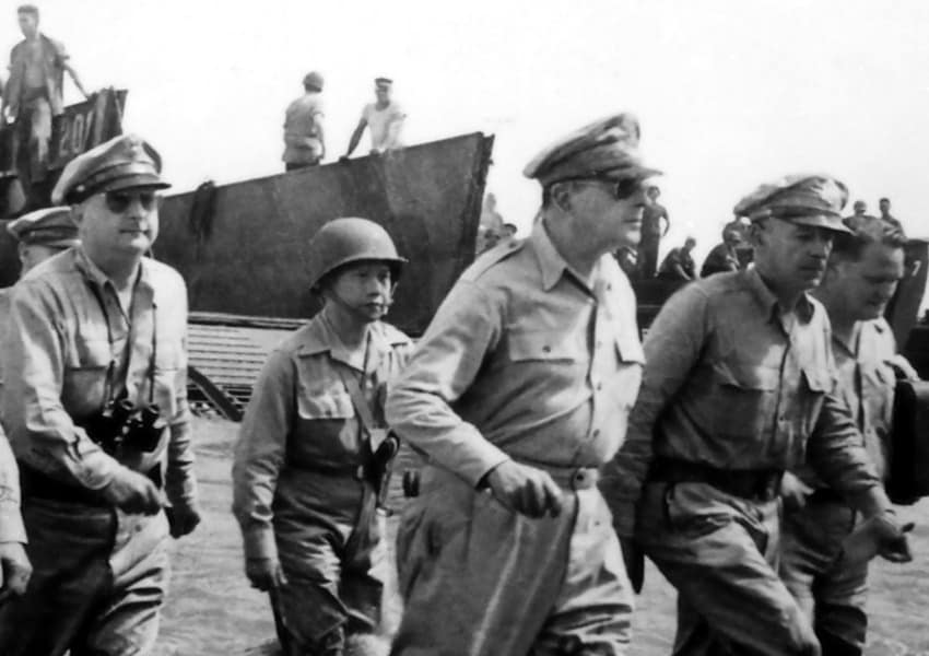 Gen. Douglas MacArthur wades ashore during initial landings at Leyte, Philippine Islands. October 1944. U.S. Army Signal Corps officer Gaetano Faillace. National Archives (NARA.)
