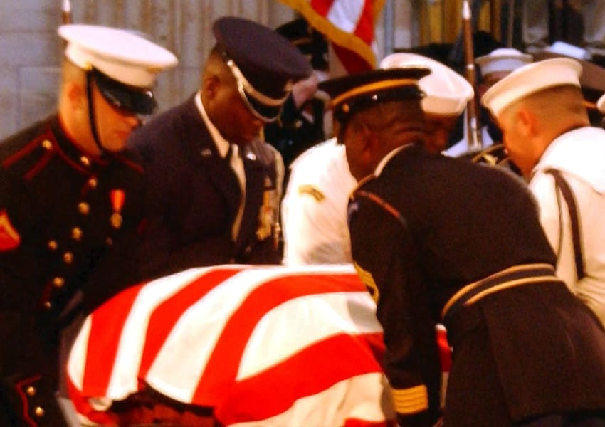 Ceremonial Honor Guard prepare to move the flag-draped casket of former President Ronald Reagan during his state funeral in the U.S. Capitol Rotunda in June 2004