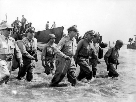 General Douglas McArthur wades ashore during initial landings at Leyte, Philippine Islands