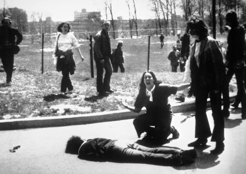 Iconic photo of woman kneeling by shot man, screaming, at Kent State Shooting.